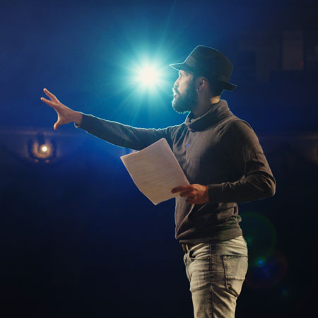 Human wearing a hat with bright light in background