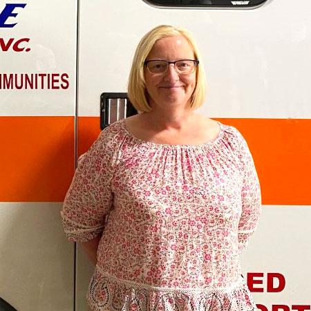 Brandy standing by ambulance photo