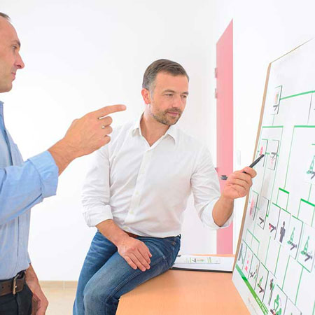 Two humans looking at a chart